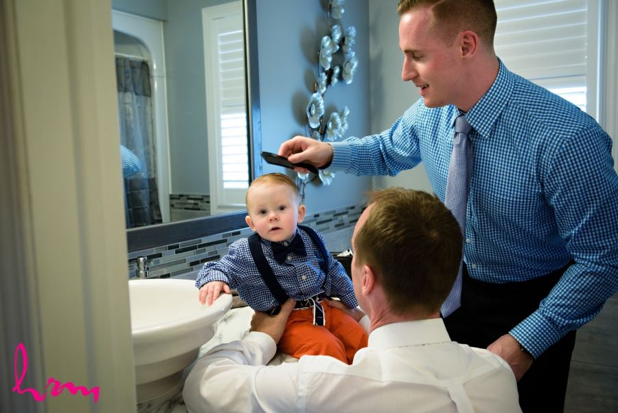Groomsmen getting ready with baby