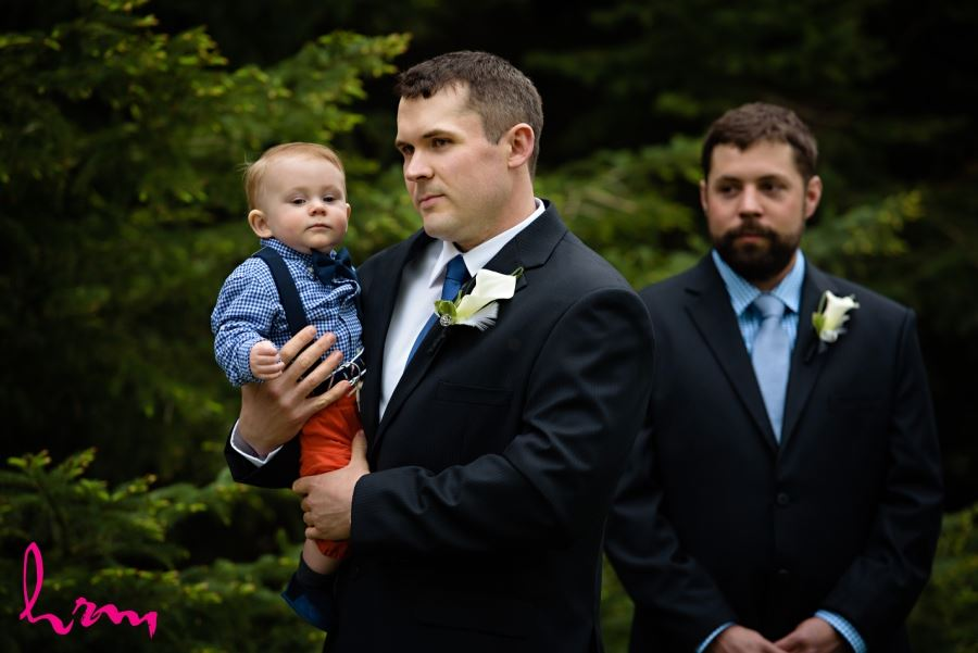 groom with baby during ceremony wedding day