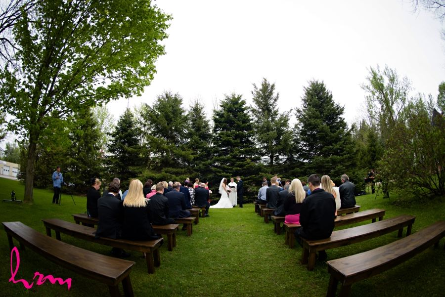 outdoor wedding ceremony wooden benches