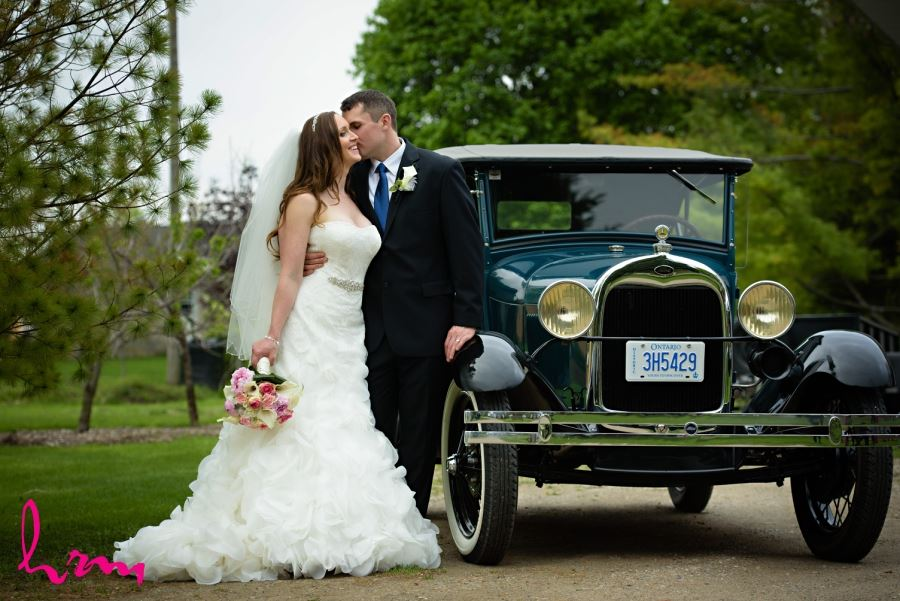 bride and groom with vintage car