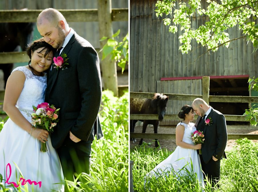 wedding day bride and groom in front of barn horse