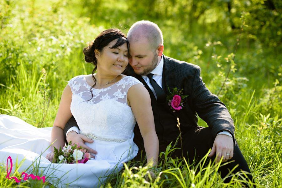 bride in groom pink boutineer