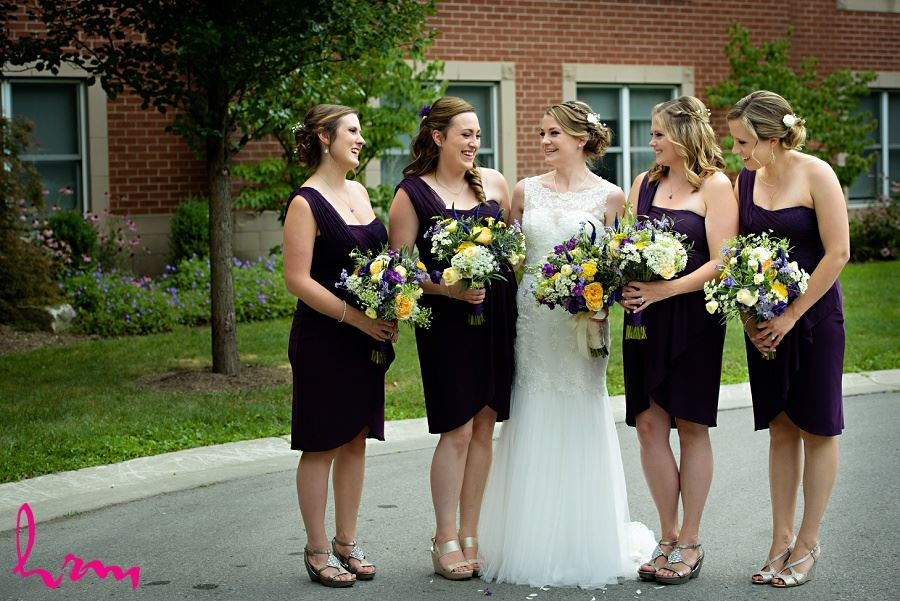Claude and bridesmaids holding bouquets, taken by HRM photography