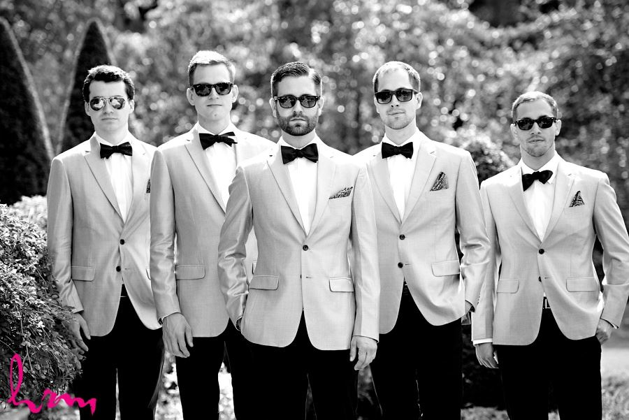 Black and white photo of groomsmen before wedding taken by HRM Photography London Ontario Wedding photographer