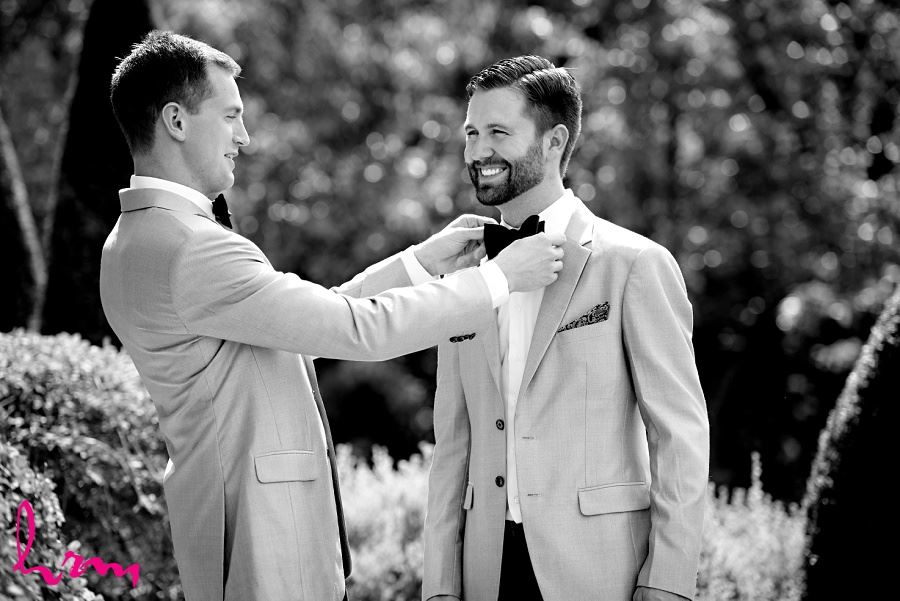 Black and white photo of bowtie fixing taken by HRM Photography London Ontario Wedding photographer