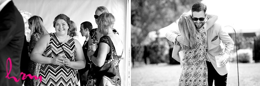 Black and white photo of greeting guests taken by HRM Photography London Ontario Wedding photographer