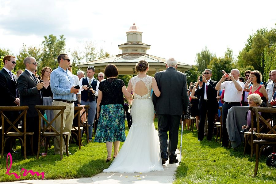 Photo of Claude walking down the aisle taken by London Ontario Wedding Photographer