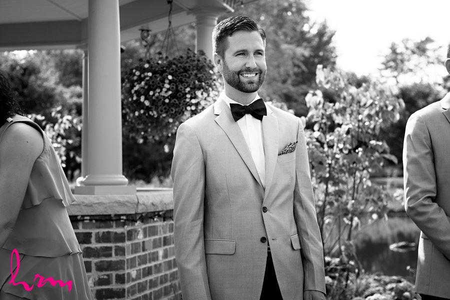 Photo of groom waiting for bride taken by London Ontario Wedding Photographer