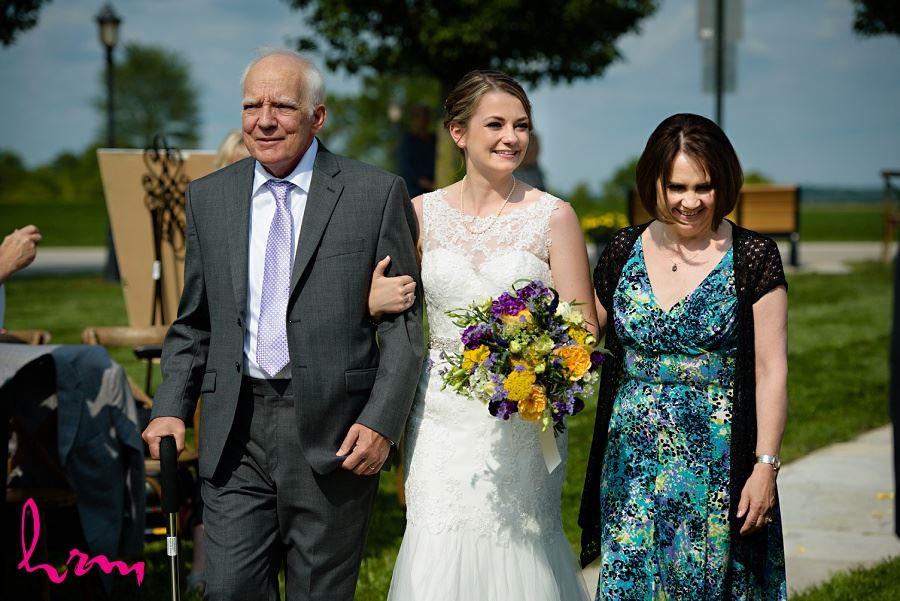 Photo of bride walking down aisle taken by London Ontario Wedding Photographer
