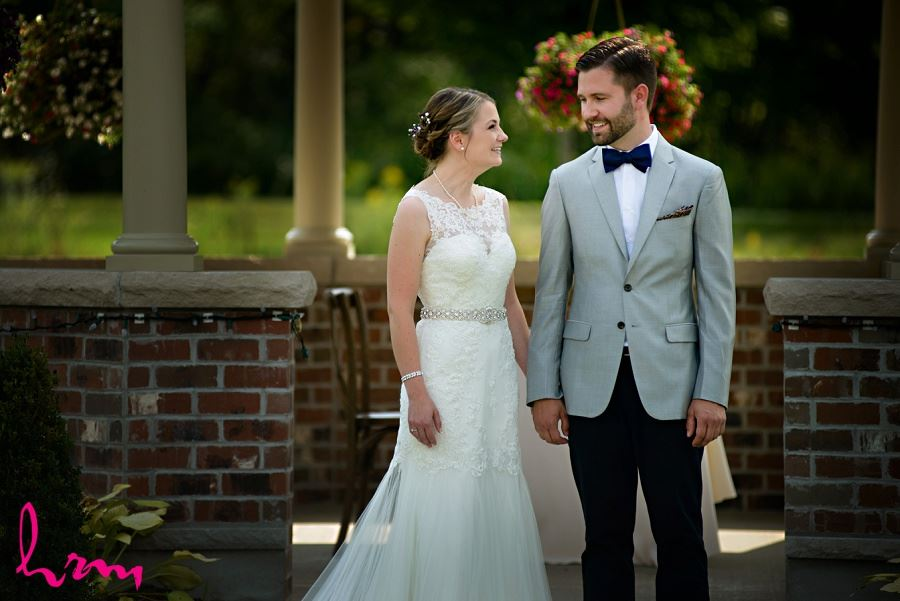 Bride and groom at outdoor wedding taken by HRM Photography London Ontario Wedding Photographer