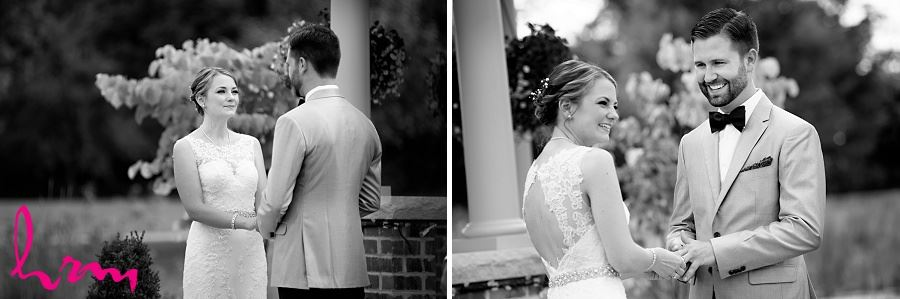 Black and white photo of putting the ring on taken by HRM Photography London Ontario Wedding Photographer