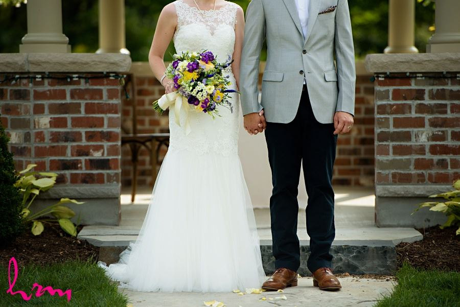 Bride and groom holding hands by HRM Photography London Ontario Wedding Photographer