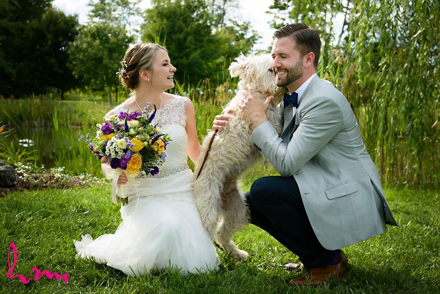 Photo of bride, groom and dog by London Ontario Wedding Photographer