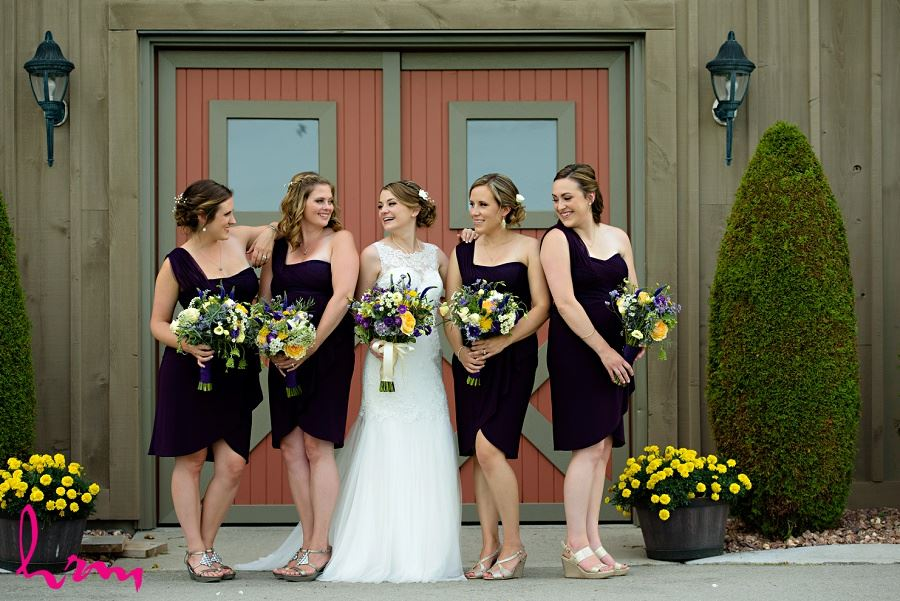 Photo of bride and bridesmaids by London Ontario Wedding Photographer