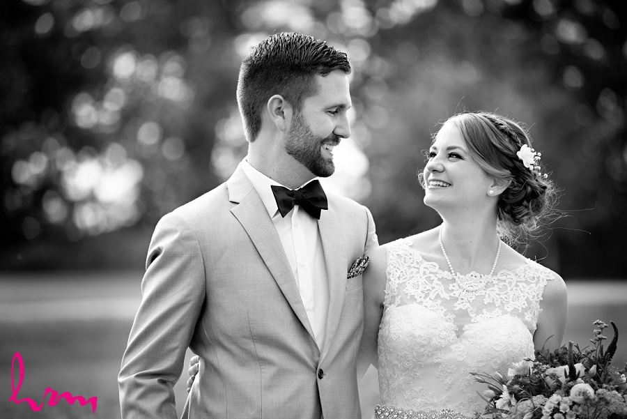 Black and white photo of bride and groom by London Ontario Wedding Photographer