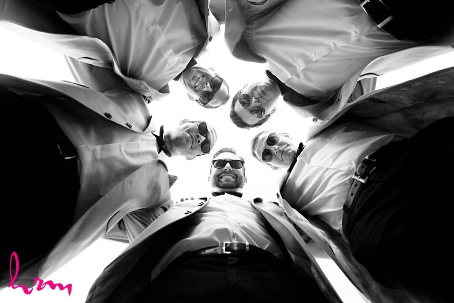 Photo of groomsmen in circle by London Ontario Wedding Photographer