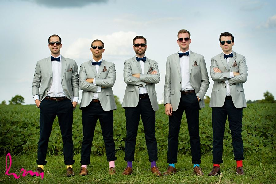 Photo of groomsmen in colourful socks by London Ontario Wedding Photographer