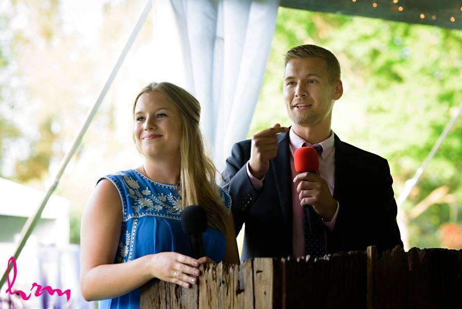 Telling stories at Claude and Jason's wedding taken by London Ontario Wedding Photographer