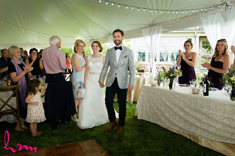 Bride and groom entering tent taken by London Ontario Wedding Photographer