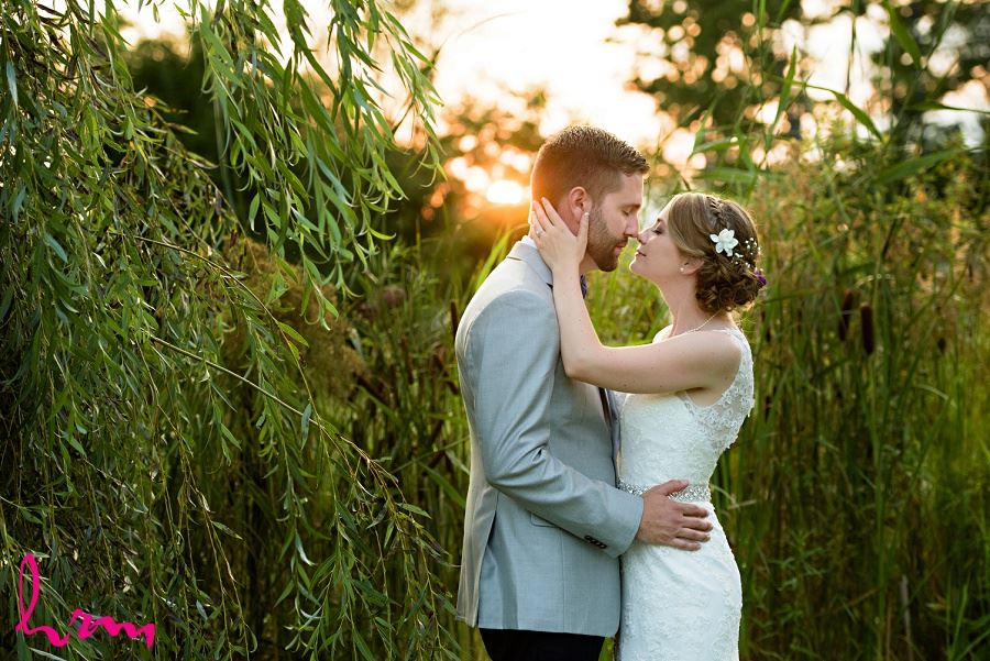 Photo of bride and groom with setting sun by HRM Photography London Ontario Wedding Photographer