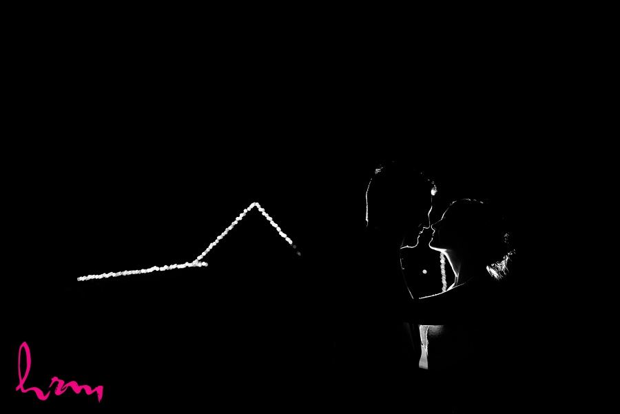 Outline of bride and groom kissing at night taken by HRM Photography London Ontario wedding photographer
