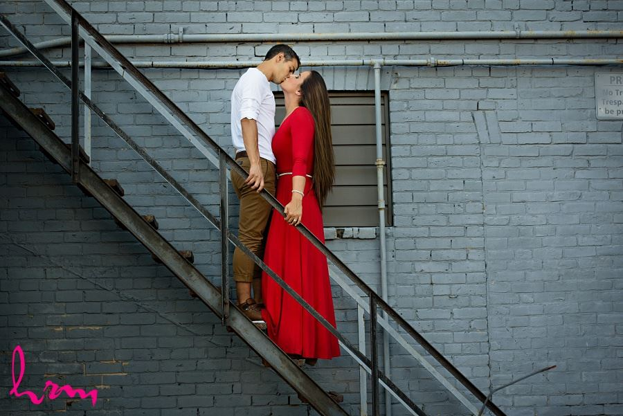 Kissing on stairs during London Ontario engagement photography session