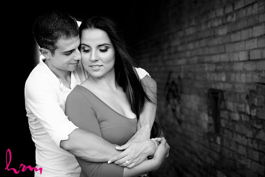 Black and white photo of Jessica and Ahmad in industrial setting taken during London Ontario engagement photography session