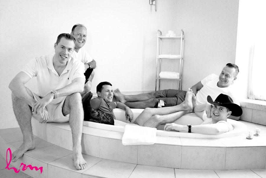 fun groomsmen picture getting ready relaxing in bathtub