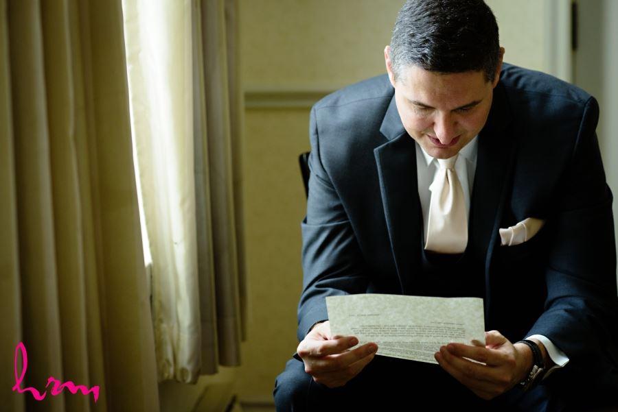 groom black suit with ivory tie
