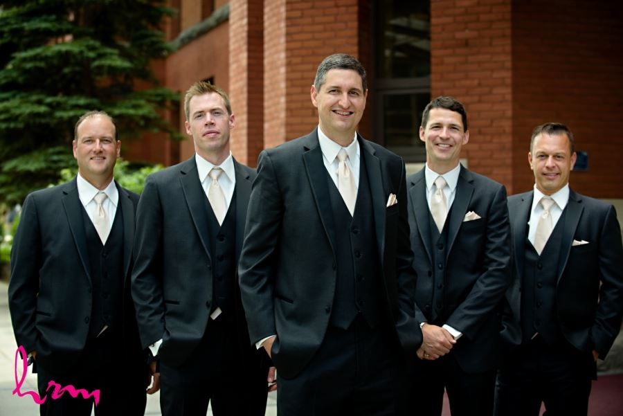 groomsmen wedding day black suit ivory tie with pocket square