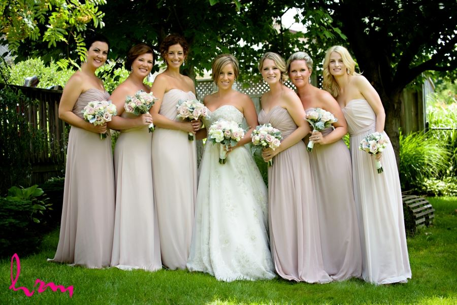 bridal party in different shades of dusty rose pink dresses