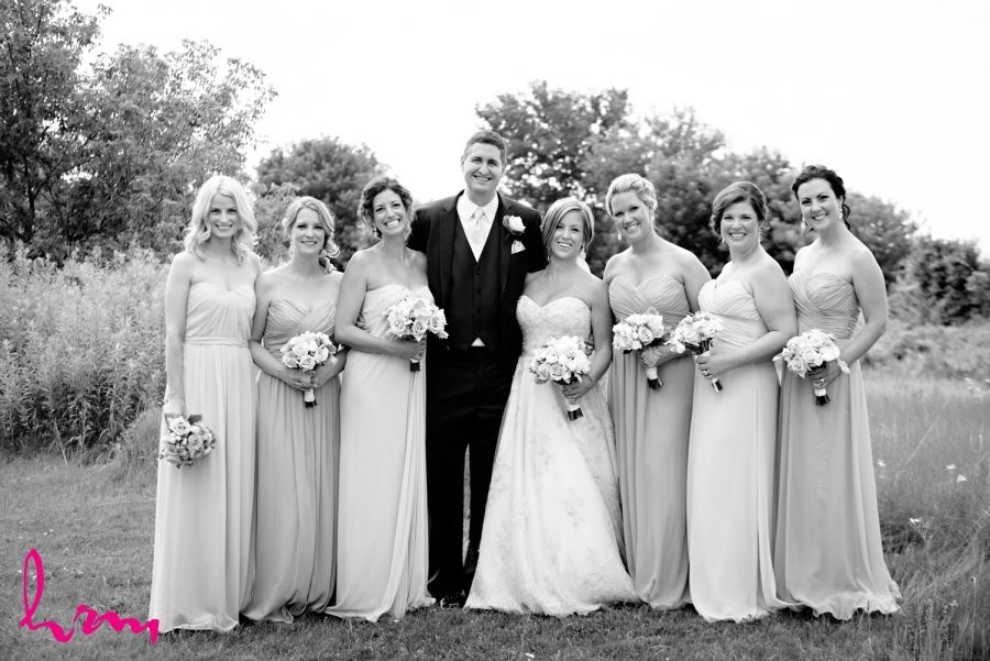 groom with bridesmaids in black and white