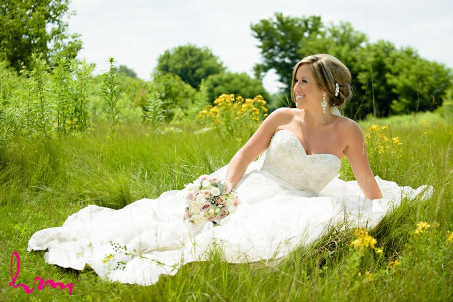 bride in meadow on sunny wedding day