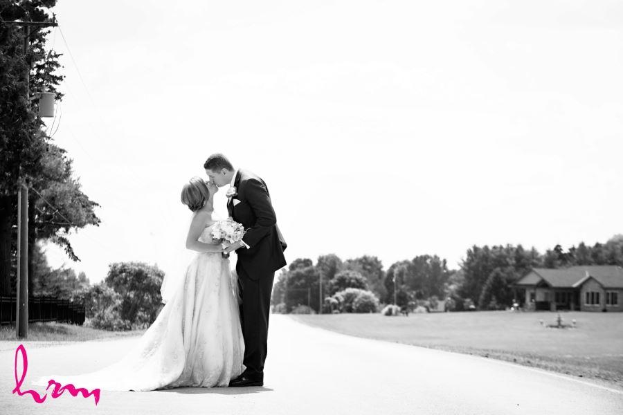 bride and groom in front of firerock golf club komoka ontario