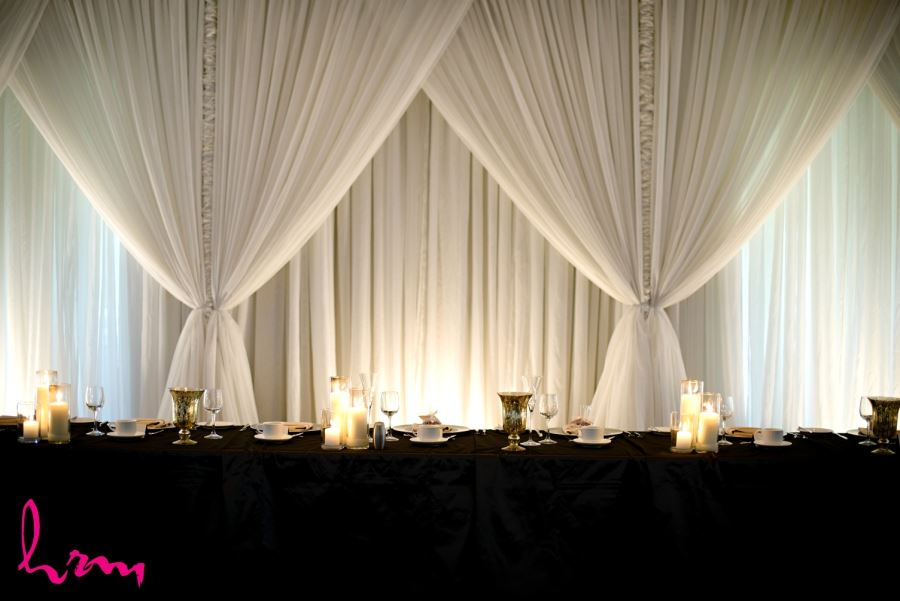 firerock golf club simple elegant head table with drapery candles silk black table cloth