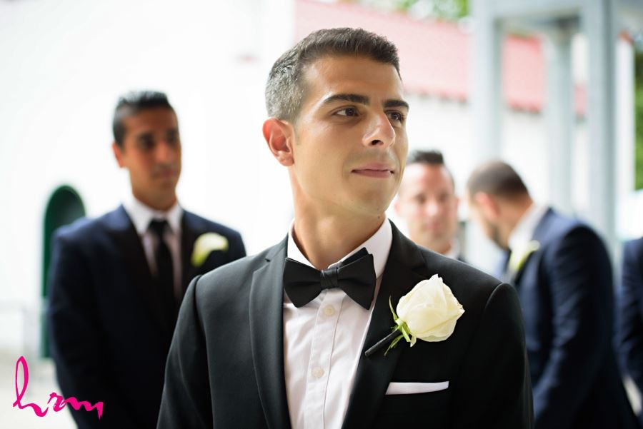 Groom with white rose boutineer