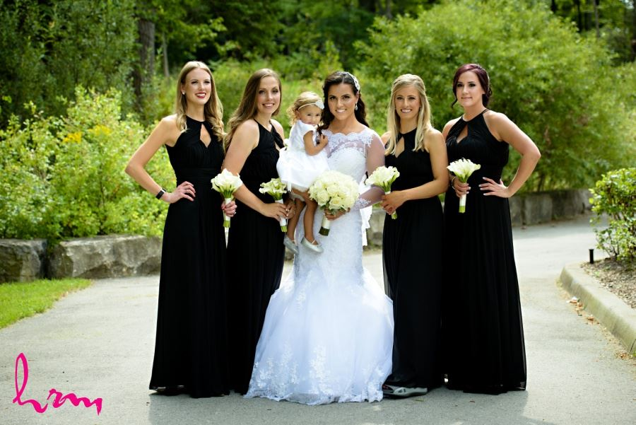 Bridesmaids and flower girl in black and white