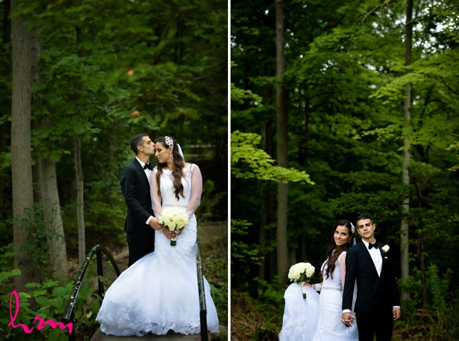 Bride and groom in wooded area