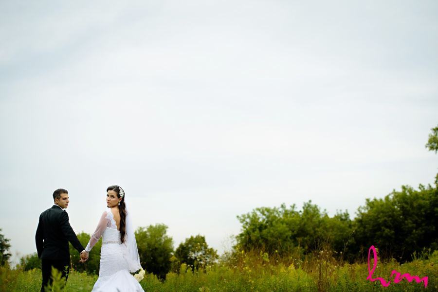 Bride and groom in meadow on wedding day