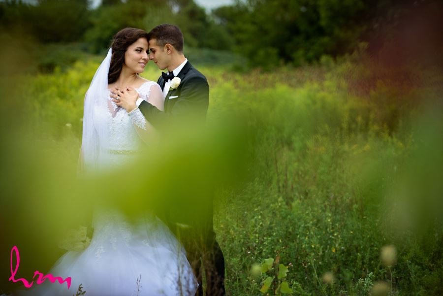 wedding day images bride and groom in meadow