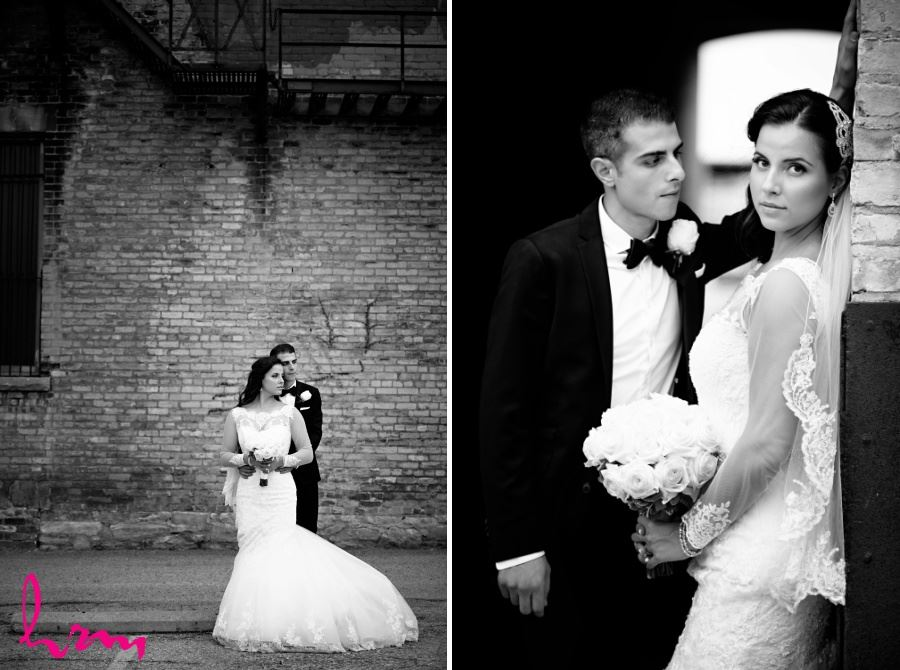 bride and groom in front of brick building