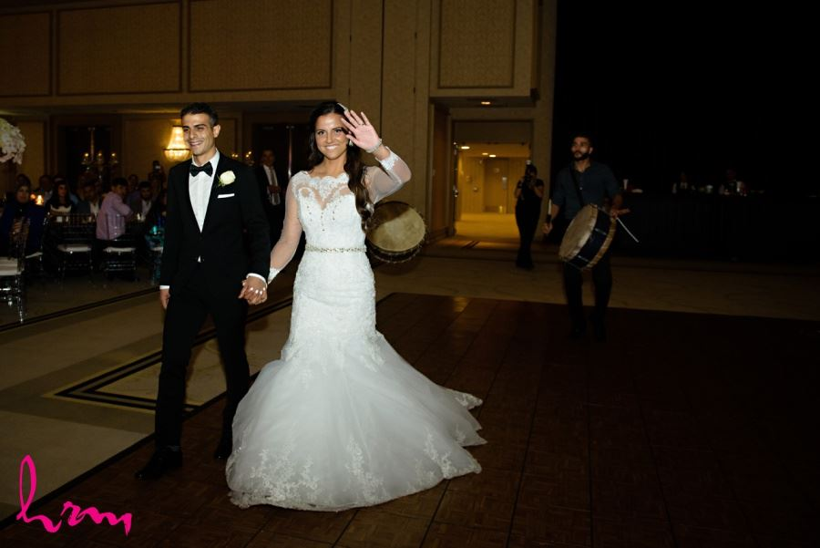 bride and groom reception entrance with drums
