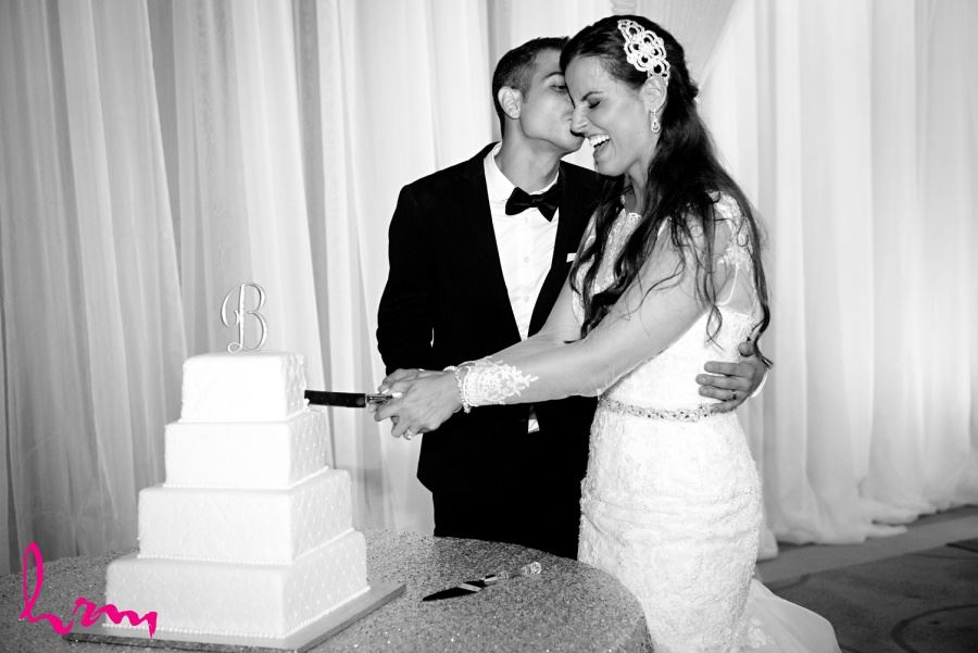 wedding reception cake cutting in black and white