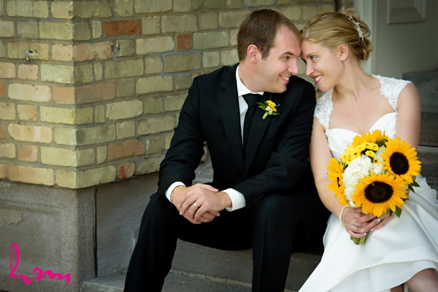 bride and groom with yellow bouquet and boutineer