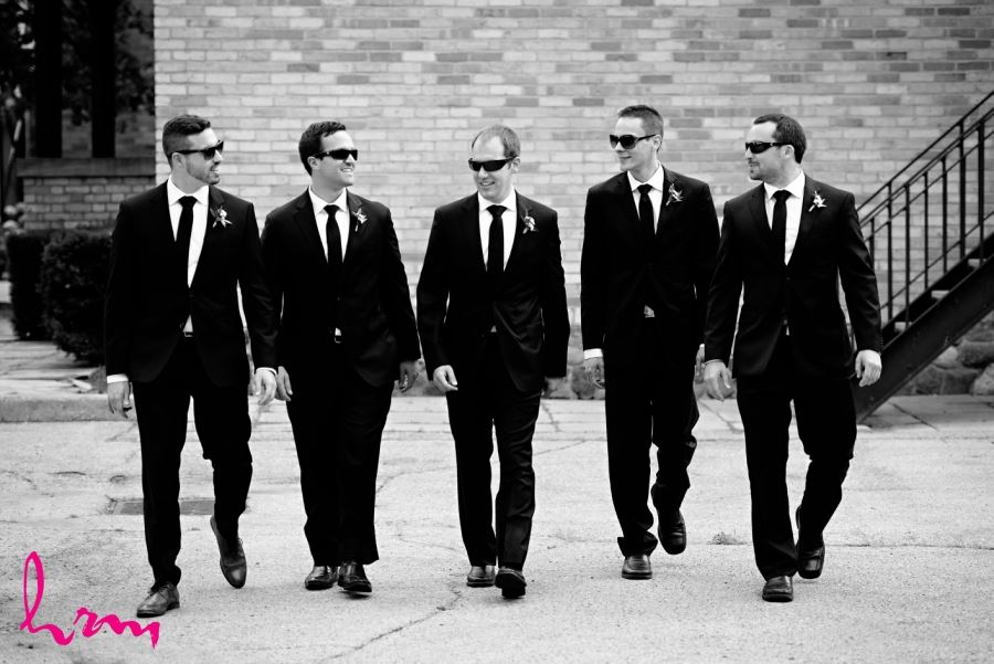 groomsmen black and white suits with sunglasses