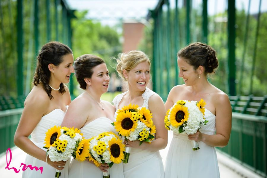 bridesmaids white dresses and yellow sunflower bouquets