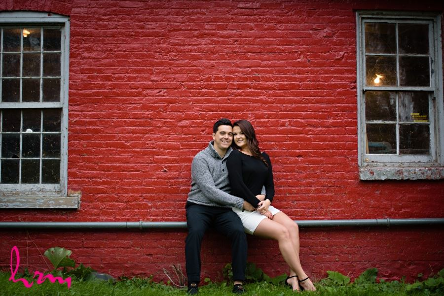 engagement session red painted brick wall
