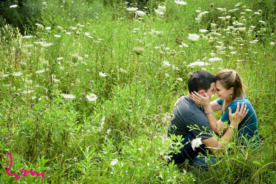 engagement session photography couple in field meadow of queen anne's lace