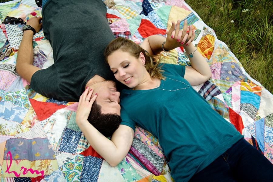 engagement session posing ideas laying on quilt