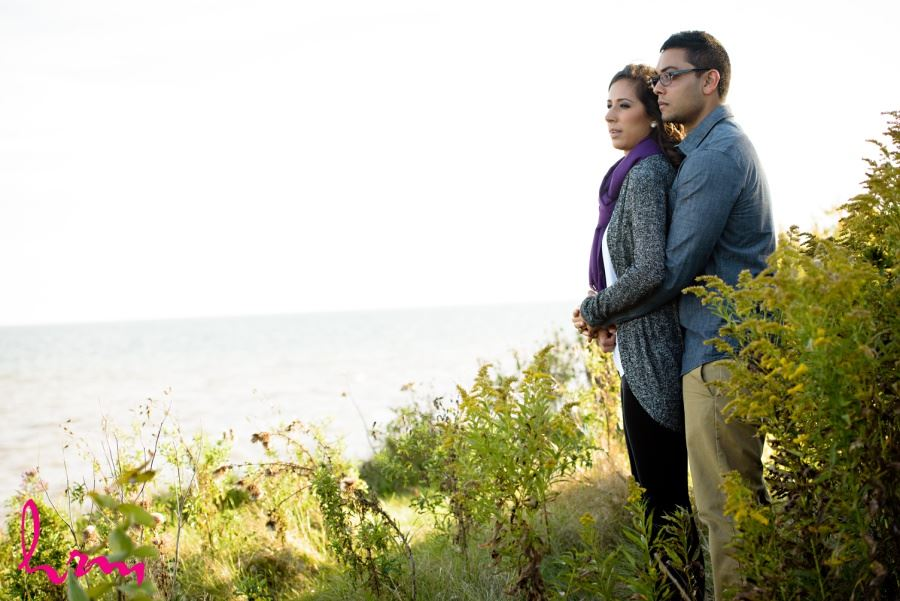 engagement session location dunes cliff looking out over water